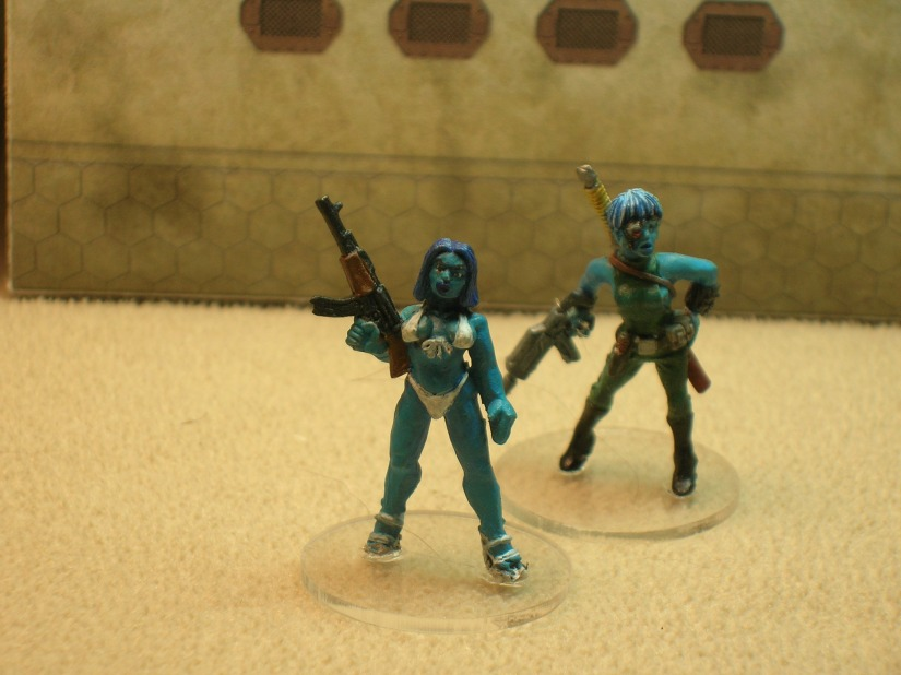 A pair of Xeogs (figure on left from Foundry; figure on right from Shadowforge)