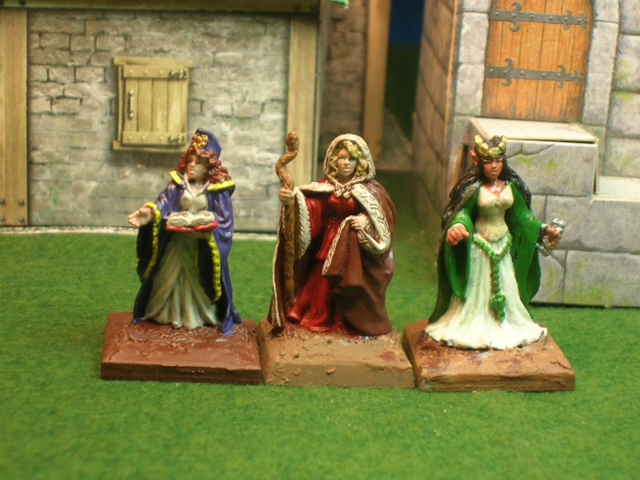 3 full skirted women, L to R: Cleric, Druid, Wood Elf Queen