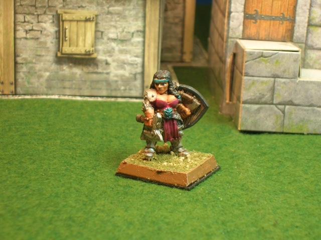 Dwarf fighter in armor.