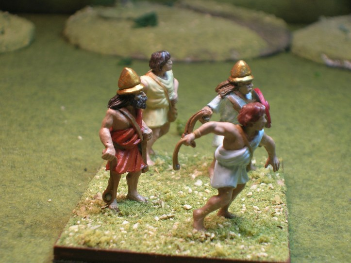 A view from the side - helmeted slingers from BTD, the other 2 are Victrix