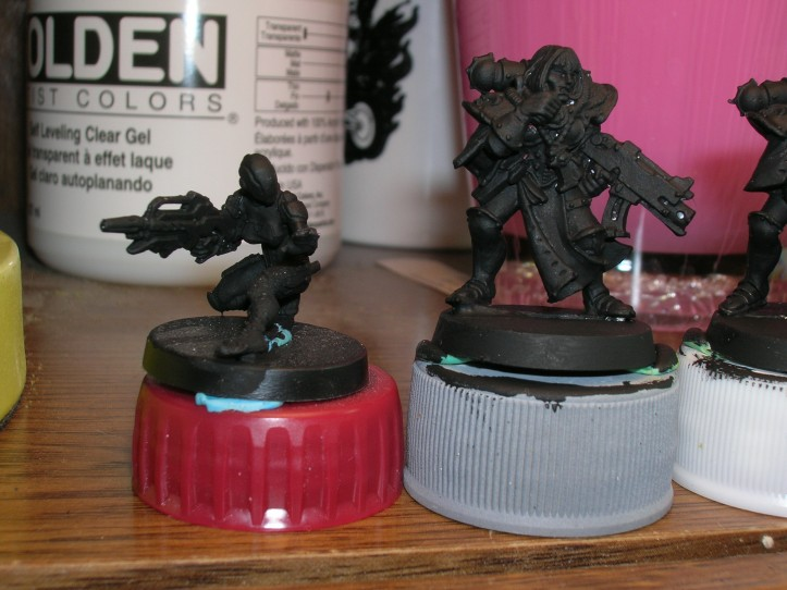 Infinity Nomad Hacker on left for Masterclass technique; GW Sisters of Battle on right for Dr. Faust technique